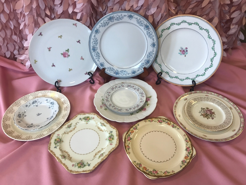 Vintage Plates<br><br>Our collection of Vintage china includes dinner plates, salad plates and cake plates. We also have coffee cups with saucers, as well as serving platters and bowls! All of the patterns are mixed and matched. These will add the perfect finishing touch to your eclectic table top!
