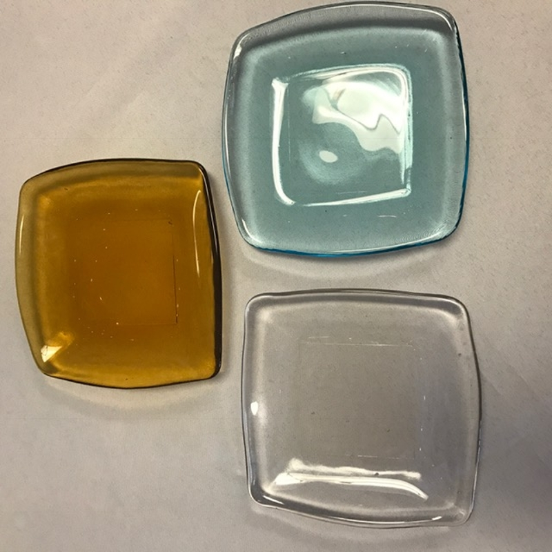 Colored Glass Square Plates<br><br>These 5.5' square plates are a perfect size for appetizers or desserts! We now offer them in Turquoise, Amber, and Clear Glass!
