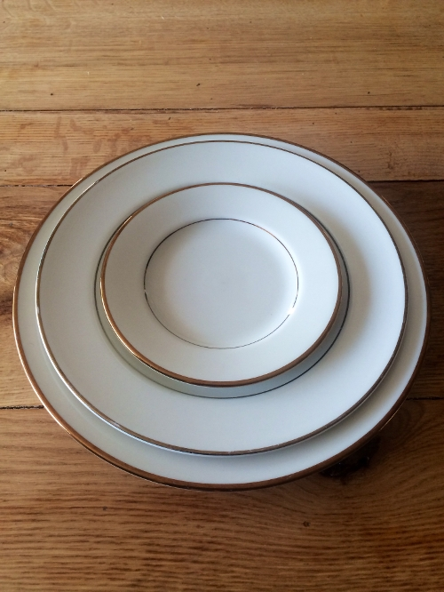 Ivory with Gold Trim China<br><br>Ivory with Gold Trim china comes in every size needed for your special event! Also available in coffee cups and saucers, soup bowls and creamers and sugars!