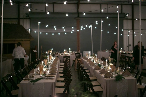Overhead Indoor Lighting with Uprights<br><br>Shown here with Tuscan lighting. Indoor overhead lighting can create a cozy, intimate feeling in a large space! (White string lighting can also be used, in place of Tuscan lighting)
