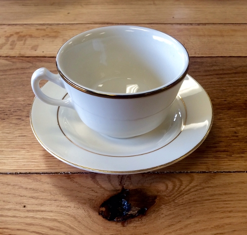 Ivory Coffee Cup and Saucer with Gold Trim<br><br>Available to rent separately or together!