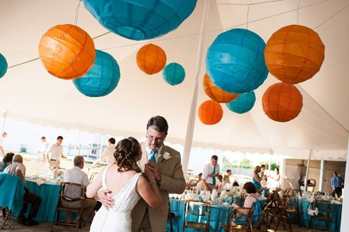 Paper Lanterns<br><br>Paper Lanterns come in hundreds of color options; they provide functional lighting plus decor for the tent top. Lanterns can be strung throughout your tent or clustered over your dance floor to create a focal point!