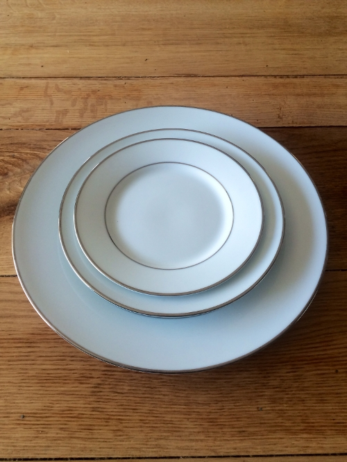 White with Platinum Trim<br><br>White with Platimun trimmed China comes in the 10' dinner plate size, 7' salad plate size, and 6' cake or B & B size. Matching cups and saucers are also available. Prices vary due to plate size needed.