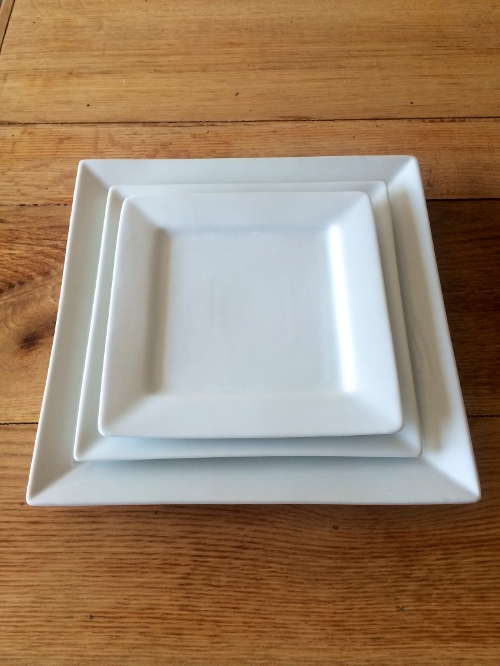 Square China<br><br>Square china comes in 10', 8', and 6' sizes, we also carry matching cups and saucers. Cocktail plates in triangle and rectangle are fun to mix and match to fit your unique event!