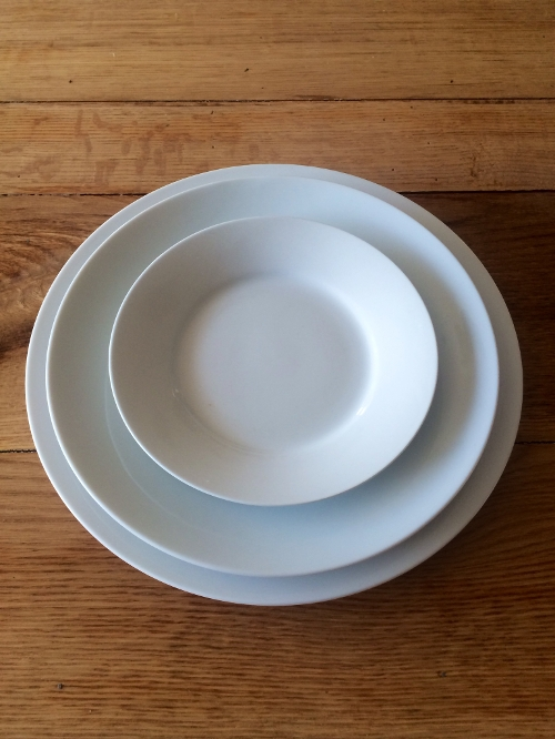 White Round China<br><br>Traditional white round china comes in a variety of sizes from the 10' dinner plate to the 6' hors d'oeuvre plates and all sizes in between! Soup bowls, cups and saucers are also available!