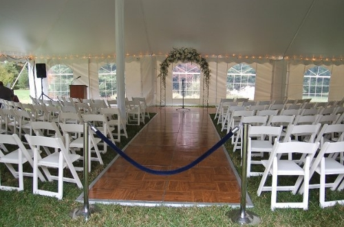 Parquet Aisle Way during a Wedding Ceremony.<br><br>Do you need a hard surface to stand on during your outdoor ceremony? How about creating a custom length and width aisle with an area up front for the wedding party to stand on during the ceremony!